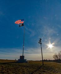 Sun Flare Memorial (John Kocijanski) Tags: odc childhoodmemory memorial flag flagpole sunflare sun field sky canon1022mmlens woodstock sullivancounty