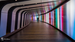 The Walker (Simon Rich Photography) Tags: london underground walker man solitude colours architecture tunnel shapes reflections simon rich simonrichphotography mrmonts
