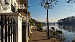 Strand On The Green, Kew. London. UK (standhisround) Tags: river riverthames strandonthegreen water building buildings boats riverbank path walk houses architecture sunny sky london kew trees lights lamplights