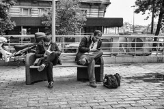 Street 237 (`ARroWCoLT) Tags: bnw bnwdemand bnwstreet ishootpeople monochrome street streetphotography blackwhite siyahbeyaz sb bw samsung sokak istanbul people tree karaköy blackandwhite outdoor 17mm f18 nxmini arrowcolt sw reading streetlife book bank bench cellphoneaddict