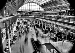 2010-08-01b Heaving crowds ([Ananabanana]) Tags: d40 nikon nikkorafsdx1855mm london st pancras station railway eurostar long exposure time movement motion blur crowds train trains nd4 light roof ceiling rail gorillapod moving people longexposure nikonistas nikonista londonstpancras eastmidlands eastmidlandsrailway gimp photoscape uk unitedkingdom 1855mm 1855 nikkor nikon1855mmkitlens nikon1855mm nikonafsdx1855mm nikkor1855mm fisheye converter optekafisheyeconverter opteka035xfisheyeconverter optekafisheye opteka slowshutter bw blackandwhite blackwhite monochrome transport railways passengers commuters commute travel
