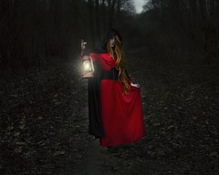 Deep in the Forbidden Forest (Rachel.Adams) Tags: forest fantasy fairytale red redridinghood dark darkart darkwoods scary creepy conceptionalphotography fineart fineartphotography search forbidden forbiddenforest deepintheforbiddenforest deepdarkwoods dress wig pale lantern photoshop portraitphotography fantasyportrait nikon