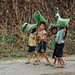 Girls With Banana Leaf Umbrellas, Oudômxai  Laos