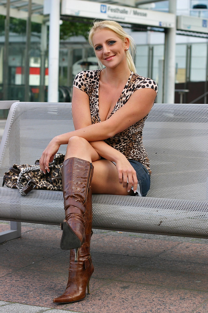 Blonde mini skirt boots commit error
