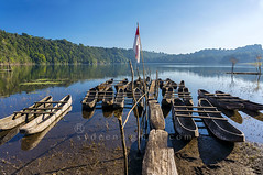traditional boat park (sydeen) Tags: park wood travel blue vacation sky bali white lake reflection green classic tourism nature water beautiful beauty indonesia landscape asian island boat scenery asia kayak natural outdoor background flag traditional parking scenic tourist exotic tropical tamblingan