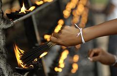 Buddhist worshipper makes an offering