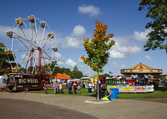 All The Fun Of The Fair (Stephen Whittaker) Tags: show old blue autumn sky people sun tree leaves car wheel clouds truck vintage wagon fun big path flag carousel fair retro jolly roger lead stalls widnes