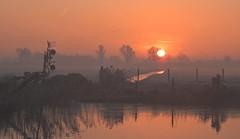 rising sun (bugman11) Tags: sun sunrise nature nikon nederland thenetherlands haarlem landscape autumn water thegalaxy platinumheartaward