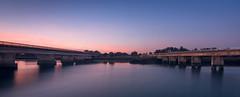 Bridges over the Ngaruroro River (lizcaldwell72) Tags: railwaybridge hawkesbay sunrise napier water sky longexposure newzealand light