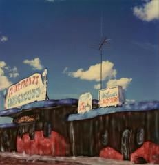 Flintstones Campground (tobysx70) Tags: polaroid sx70 sonar emulsion manipulation time zero tz instant film flintstones bedrock city grand canyon highway hwy 64 180 williams arizona az sign campground cartoon animation theme amusement park wilma's laundry yabbadabbadoo hannabarbera tv television antenna aerial blue sky clouds toby hancock photography