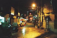 SAIGON NIGHTLIFE AT SLUM (Veronica Vu) Tags: saigon nightlife streetlife lomography film filmphotography filmisnotdead nikon nikonfe nikonfilmcamera ishootfilm