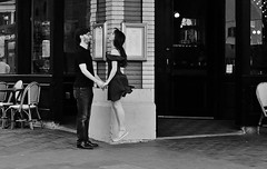 Floating (burnt dirt) Tags: houston texas mainstreet street sidewalk building office downtown city town bw blackandwhite fujifilm xt1 girl woman people person jump fly float flying floating jumping standing couple pair restaurant brick table chairs glasses longhair beard