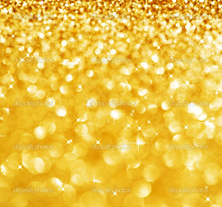 Christmas Glittering background.Holiday Gold abstract texture.Bokeh