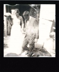 Jeunes maris du temps de paix (mathieugleizes) Tags: street wedding party people bw woman sun man love strange real polaroid soleil peace time pierre magic femme sunny fete soul instant mariage rayon rue guerre pola 1000 homme mathieu paix instantan polarod gleizes polarod1000