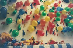 Balloon Toss (Anne Abscission) Tags: carnival night analog 35mm balloons lights washington colorful availablelight games softfocus darts olympustrip35 amusements everett 400asa sausagefest olympustrip filmphotography ferraniasolaris balloontoss sausagefestival