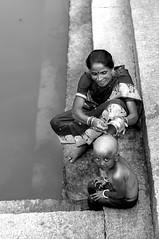 At the Temple Pond of Bhoga Nandeeshwara, of which you may not have heard much.. (Anoop Negi) Tags: woman india water photography photo pond child south bangalore hills ritual nandi karnataka anoop negi cleansing bengaluru ezee123 teertha bhoga shringi nandeeshwara boginandishwara