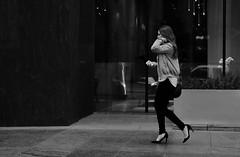 High Heel Hair Flip (burnt dirt) Tags: houston texas mainstreet downtown street streetphotography city town bw girl woman people person sidewalk building office officeworker cold jacket heels highheels longhair cellphone walking fujifilm xt1