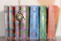Week 2: The Golden Snitch! (Mitchell Corsack | MAC Photography) Tags: dogwood52 dogwood2017 dogwoodweek2 nikon macphotography harry potter harrypotter hp snitch books necklace watch