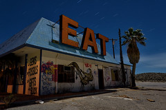 EAT. mojave desert, ca. 2016. (eyetwist) Tags: eyetwistkevinballuff eyetwist sign eat food restaurant palmtree roadsideamerica halloransprings abandoned gasstation mojavedesert dark night longexposure fullmoon moonlight mojave desert nikon d7000 nikkor capturenx2 1024mmf3545g npy nocturne highdesert america americana americantypology landscape startrails star trails type typography typographic signgeeks vintage american west roadtrip california lightpainting peeling weathered worn neon i15 interstate gasoline servicestation closed decay lasvegas derelict ruin roadside exit diner gas station 1024mm roof logas gems fossils building sansserif orange
