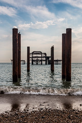 Dereliction (Anthony P26) Tags: architecture brighton category decay eastsussex england external places seascape travel westpier coast coastal coastline sea englishchannel britain british greatbritain uk unitedkingdom canon canon70d canon1585mm structure building pier waves shore breakingwaves sand pebbles reflections reflectedlight bluesky evening clouds whiteclouds outdoor corrosion ruin rust derelict bird birds water