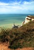 Beachy Head Lighthouse (Heaven`s Gate (John)) Tags: ocean blue red sea england sky lighthouse white seascape building english water sunshine architecture landscape sussex chalk dangerous waves view head stripes drop cliffs ripples tranquil channel beachy 10faves johndalkin heavensgatejohn