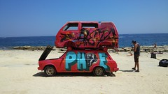 PH (mask) E (Kr3li4n) Tags: sea summer art beach car festival vw island graffiti rocks paint outdoor malta van