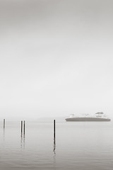 at anchor in the fog.jpg (dwoodpics) Tags: water fog portland boats blackwhite maine coastal anchor daytime nautical commercialboat