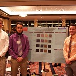 Students posing with their environmental science research poster.