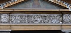 Entrance porch architrave marble frieze, Gregory VII, c1080 - Basilica di Santa Pudenziana, Rome. (edk7) Tags: nikond300 edk7 2010 italy italia lazio rome roma basilicadisantapudenziana entranceporchgregoryviic1080 architrave medievalmarblefrieze relief basrelief sculpture stonecarving church exterior art architecture building oldstructure detail floralmotif lambofgodchristsymbol martyrvirginsisterspudentianaandpraxedis fatherpudens stpeter 19thcfresco nikonafsnikkor70200mm128giiednanocrystalcoatswmvredif