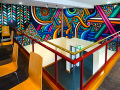 The Top Floor of the Canterbury Museum (Steve Taylor (Photography)) Tags: mural streetart museum railing chair colourful canterbury newzealand nz southisland christchurch waves sea ocean curve leaves circle diamond diagonal triangle balcony eye drip mosaic cafe restaurant