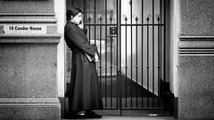 Making Plans (Sean Batten) Tags: london england unitedkingdom gb blackandwhite bw streetphotography street city urban person stpauls nikon d800 70200 mobilephone condorhouse gate
