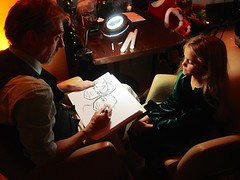 Drawing The Kids' Caricatures (Joe Shlabotnik) Tags: manhattan caricature violet rockefellercenter newyorkcity december2016 nyc 2016 60225mm