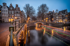 Bridge lights (angheloflores) Tags: amsterdam canal houses keizersgracht bridge lights cityscape arquitecture travel night clouds sky colors urban explore netherlands reflections