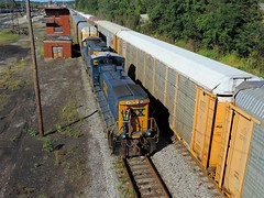 Working the racks (Trains & Trails) Tags: diesel pennsylvania engine transportation rco worker locomotive railyard freight employee railcars trainyard switcher csx fayettecounty connellsville emd autoracks 1181 darkfuture mp15ac yn3 y29014 remotecontroloperator