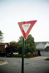 000097630018 (J E) Tags: street film sign 35mm canon triangle fuji yield canonet ql17 giii 400h