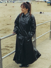 A Wet Look Trench at a windy Beach (betrenchcoated) Tags: sexy flying shiny wind windy blowing trenchcoat flapping raincoat pu beautifulgirl regenmantel flattern patentcoat