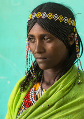 Portrait of an Afar tribe girl with braided hair and nose ring, Afar region, Semera, Ethiopia (Eric Lafforgue) Tags: adult afar africa africanethnicity assaita beads beautifulpeople beauty braidedhair braids colourpicture danakil eastafrica ethio17289 ethiopia ethiopian ethnic greenbackground hair haircut headband hornofafrica indigenousculture islam jewelry lookingatcamera muslim nomadicpeople nosering onegirlonly oneperson oneteenagegirlonly outdoors pastoralist photography portrait semera traditionalclothing tribal tribe vertical waistup woman women afarregion