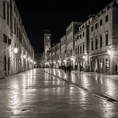Stradun (McQuaide Photography) Tags: dubrovnik croatia hrvatska dalmatia ragusa europe sony a7rii ilce7rm2 alpha mirrorless 1635mm sonyzeiss zeiss variotessar fullframe mcquaidephotography adobe photoshop lightroom tripod longexposure street urban city blackandwhite blackwhite bw mono monochrome old oldtown oldstreet oldbuilding medieval middleages character atmosphere architecture light reflection streetlight history historic historical historicalbuilding unesco unescoworldheritage heritage oldplace placa stradun stradone limestone paved pedestrian belltower franciscanmonastery square squarecrop 11 night nightphotography toned toning