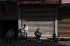 At Charminar (Ravikanth K) Tags: 500px charminar street people morning light shadows dog tea chai winter warmth sunlight shutter shops closed bangles telangana hyderabad