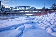 more snow on The Bow (John Andersen (JPAndersen images)) Tags: 12monthsofthesameimage 2017 bowriver calgary centrestreetbridge city cold ice january langevinbridge skyline snow towers winter