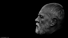 What will the new year bring ? (Neil. Moralee) Tags: neilmoralee neil moralee nikon man face portraite profile black white bw mono monochrome blackandwhite old mature beard balding blackbackground zoom candid dark sinister alone devon beer p7000