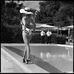 Swimming pool (Radoslaw Pujan) Tags: woman swimmingpool waiters cannes cotedazur hasselblad ilford hp5 scene story film analog riviera hat swimsuit elegance classy luxury