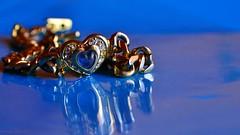 Heart on blue - MM (Zsofia Nagy) Tags: macromondays heart macro jewelry bokeh d3100 depthoffield dof tabletop flickrlounge blue