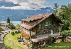 Swiss Cottage (Smartin69) Tags: flowers blue house lake switzerland wooden swiss cottage shutters dwelling brienze
