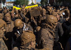 iranian shiite muslim men covered in mud carrying a coffin during ashura, the day of the death of imam hussein, Kurdistan Province, Bijar, Iran (Eric Lafforgue) Tags: street people man male men festival horizontal dead religious outdoors death sadness togetherness persian kid mourning mud iran islam traditional religion crowd crying middleeast culture persia celebration males shia ritual muharram ashura muslims tradition coffin hussein adultsonly trance allah symbolic iman commemoration kurdish kurd kurds shiite ashoura hussain achoura persiangulfstates   15813 largegroupofpeople colourimage  iro kurdistanprovince shiism  unrecognizableperson kordistan bijar westernasia