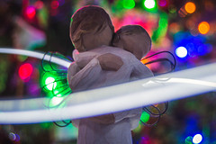 In The Arms Of The Angel (NVOXVII) Tags: hmm macromondays macro bokeh lighttrails slowshutter colourful xmas christmas figurine festive lights angel december emotive spiritual holy dof depthoffield sculpture