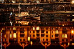 Boat in the dark (MattSnapsPhotography) Tags: night building water port windows christmas orange ship moor tree river dark bristol docks avon house roofs harbour mast reflection astic
