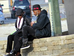 IMG_7807 (kennethkonica) Tags: canonpowershot canon global random hoosiers outdoor talking candid street streetphotography marioncounty midwest america usa indiana indianapolis indy hat sit sitting seat seated bottle fedora people persons blackclothes couple mood atmosphere bodylanguage pensive winter february