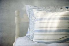 Resting (jm atkinson) Tags: pillow light bedroom blues whites seaside decor texture