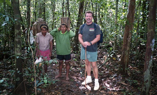 Willie and 2 porters travel through the jungle
